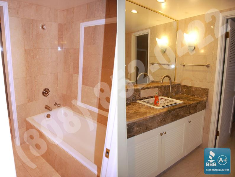 All marble bath with deep soaking tub and separate shower stall.