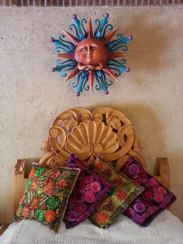 Handmade wooden headbroad with mexican textiles.