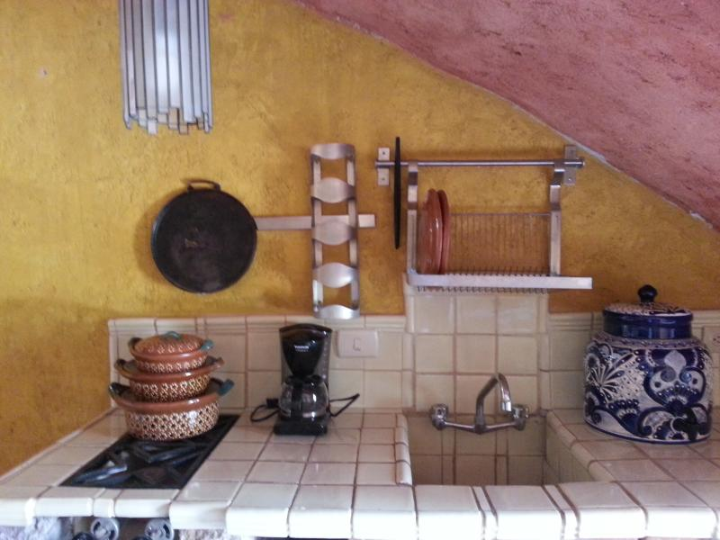 Small kitchen with two stoves, microwave, coffee maker and all you need for a comfortable stay.