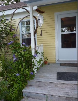 Entry to kitchen with clematis vine