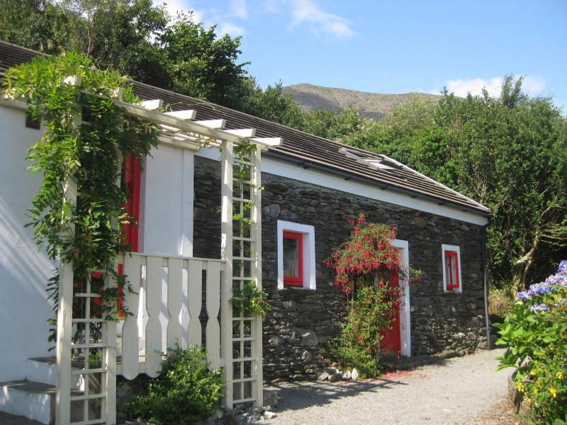 Four Directions Cottage with Hungry Hill in the background