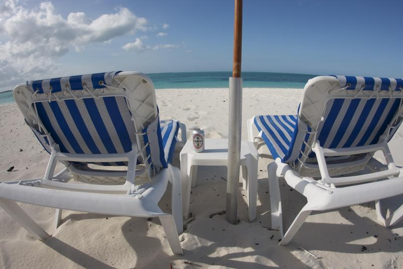 Beach chairs and umbrella provided