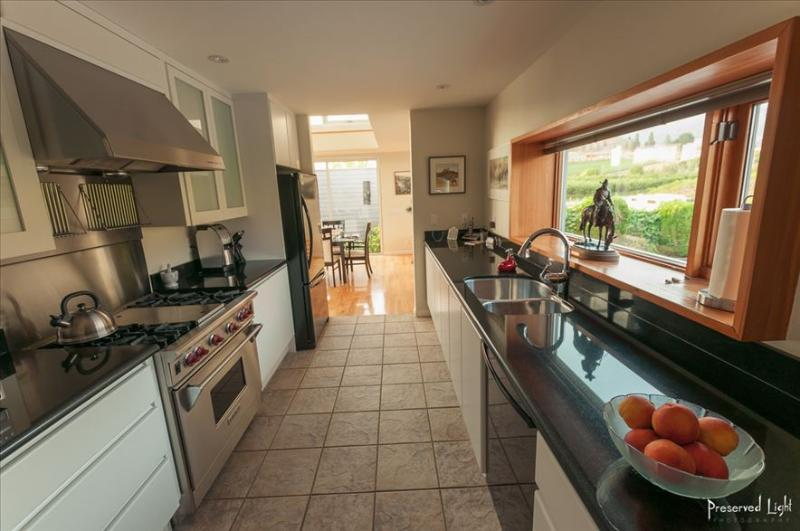 """A fully appointed kitchen with a """"Wolf"""" gas stove and oven great for cooking your own gourmet meals."""