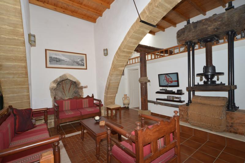 Restored Venetian Olive Press in the Living area, with TV, Satellite and DVD player