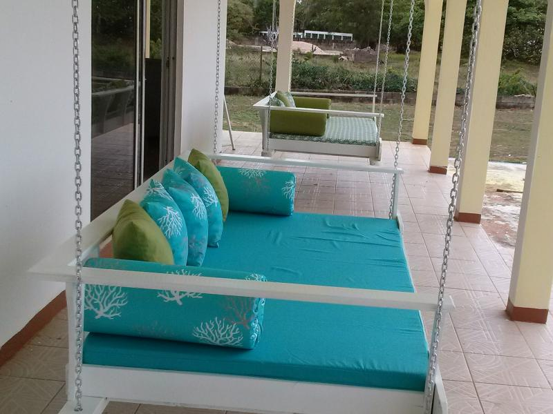 Swinging deck chairs. Rear of property