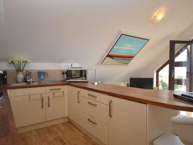 Modern fitted kitchen with integrated appliances