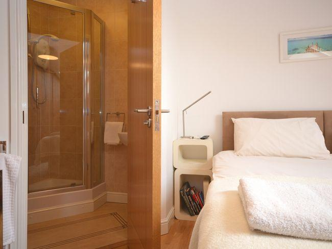 King-size double bedroom (with zip-and-link beds) with en-suite shower room