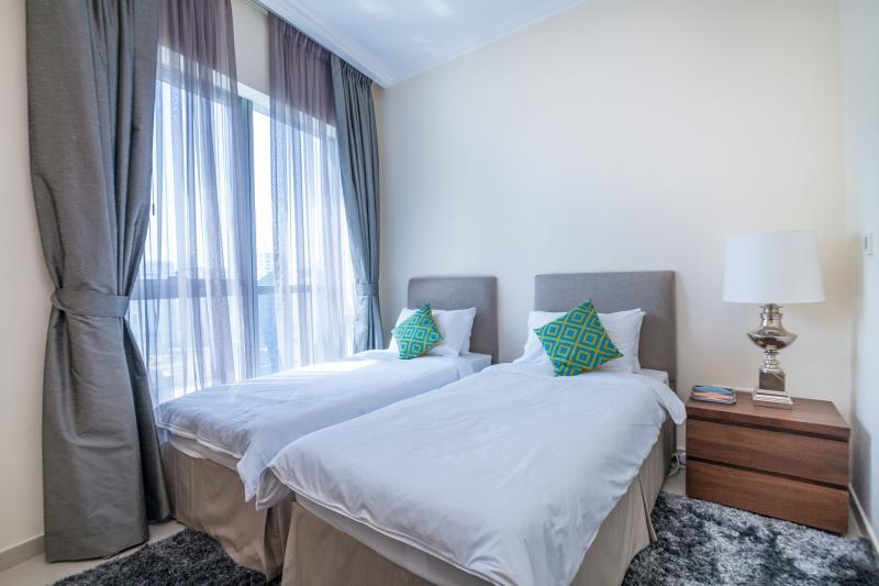 Quarto 3 - camas de solteiro que podem ser feita como rei cama de casal. Grande vista sobre a Marina