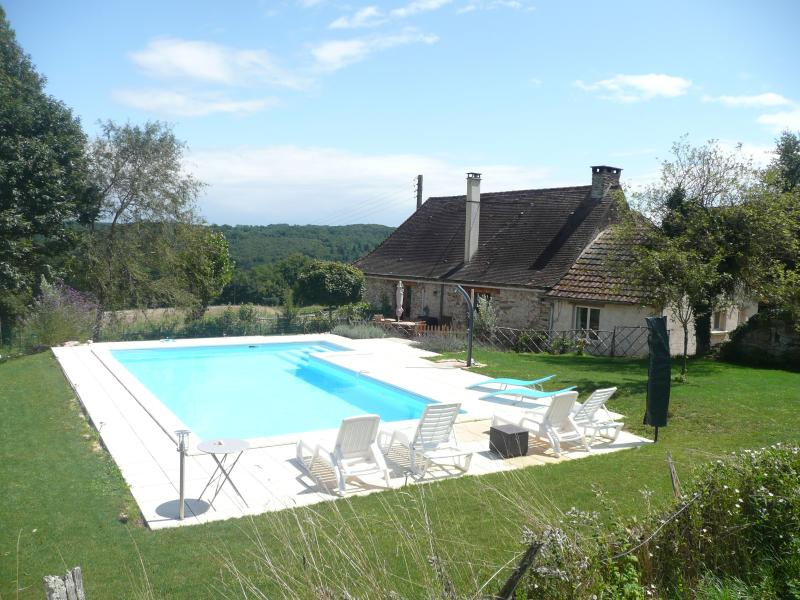Heated pool and house, with open countryside views