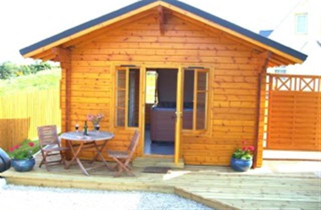 Outside of log cabin & Hot Tub at cottage no. 1.