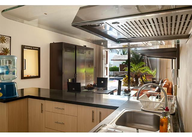 Granite countertops with lots of space.  Kitchen well stocked with everything you need