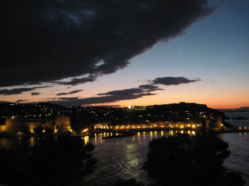 The view from Studio des Anges at night with the Château Royal to the left.