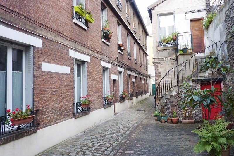 a charming property built in 1800, with a flowered courtyard
