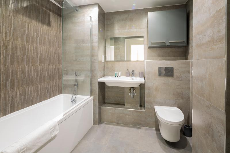Spacious family bathroom with bath and shower.