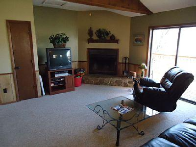 Wood burning fireplace with comfy leather recliner.