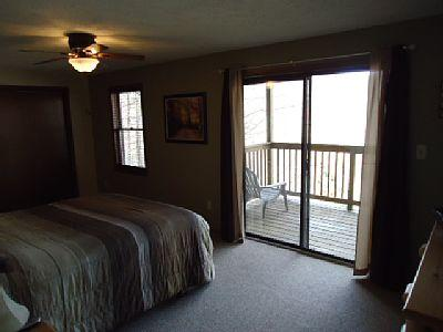 Master bedroom with private balcony overlooking the mountain side.