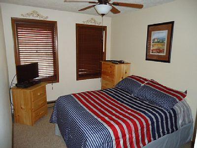 Spare bedroom with flat screen T.V. and new mattress.