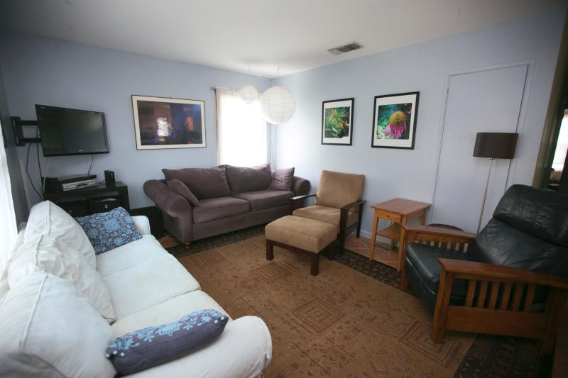 Living room has seating for 8. The couches can be used as beds as well.