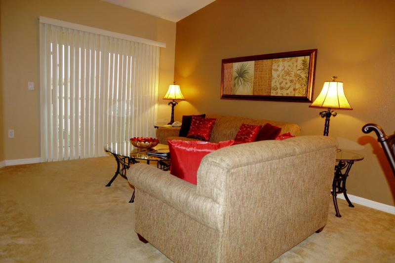 Spacious living room with access to screened balcony