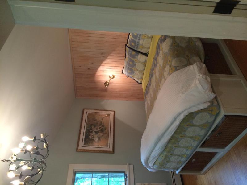 master bedroom & doors to the patio