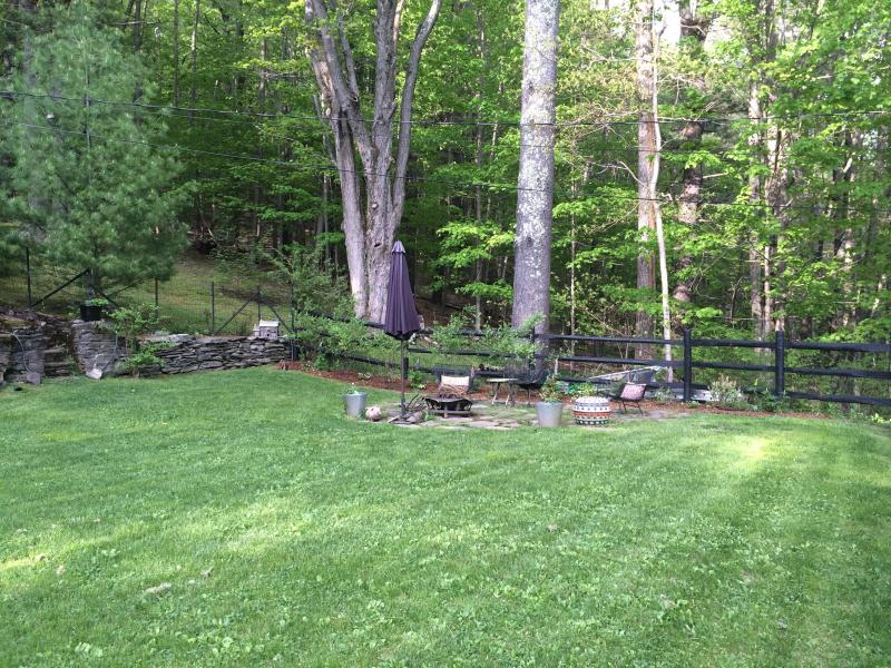 front fenced in garden and seating fire pit
