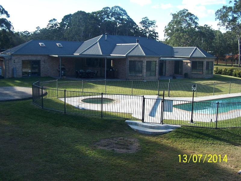 Rear of property overlooking pool area
