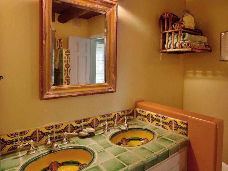 Full bath with double sinks and stand-alone shower