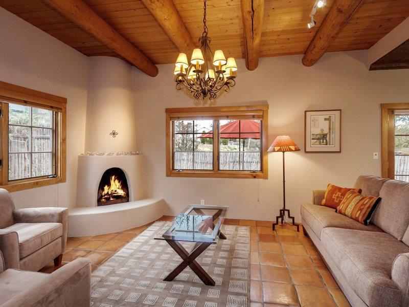 Living room with kiva fireplace and flat screen TV