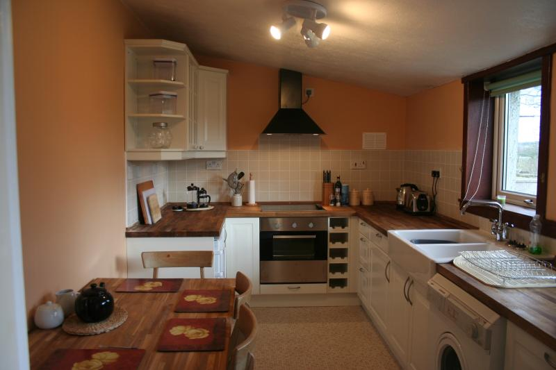 The kitchen has all mod cons and a small eating area