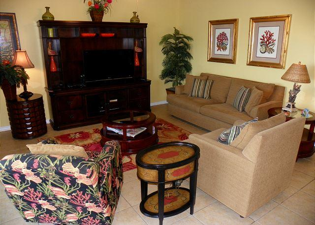 The living room has plenty of comfortable seating including a sleeper sofa.