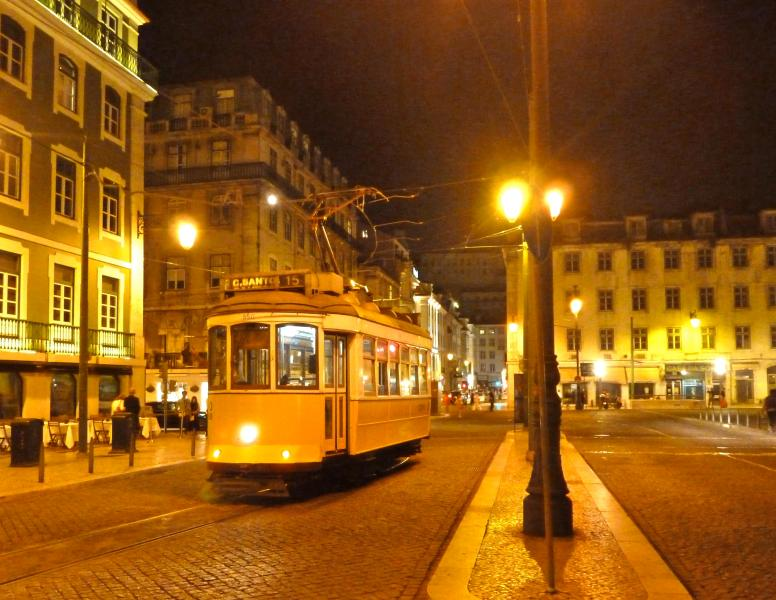 Tram 15 taking you to Belem on Rossio square at night