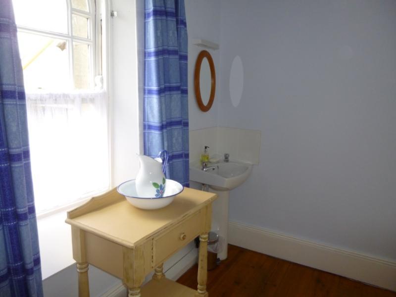 Bathroom with period and modern wash basin