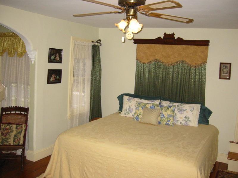 King Bed in Large Six Window Bedroom