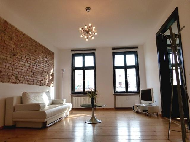bright living room, high ceilings, huge windows