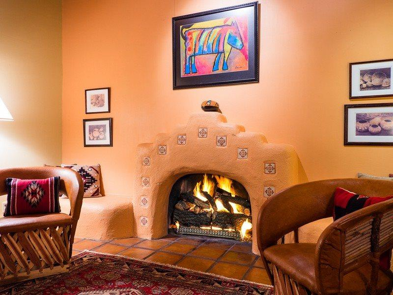 Living room of Felicidad with working fireplace