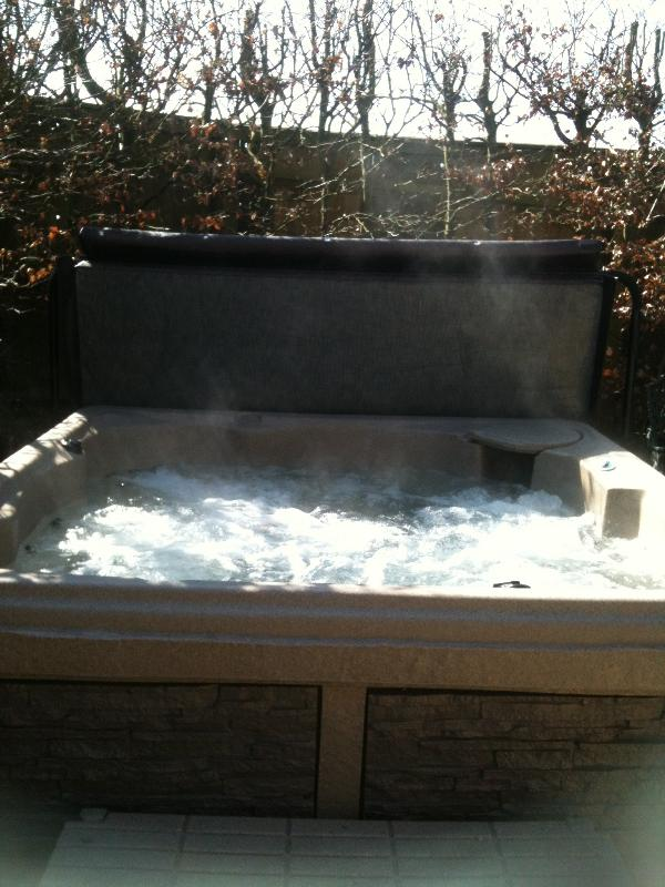 Outside hot tub in private patio garden for your use only.