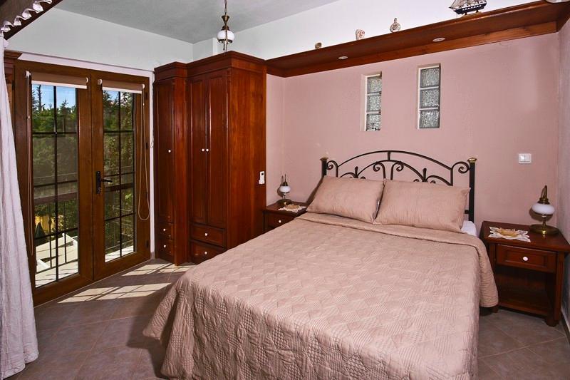 Double bedroom with Juliet balcony overlooking garden and pool