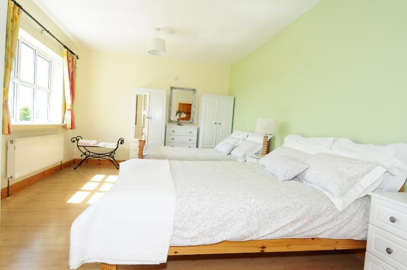 This double room is part of the suite and has two comfortable double beds.