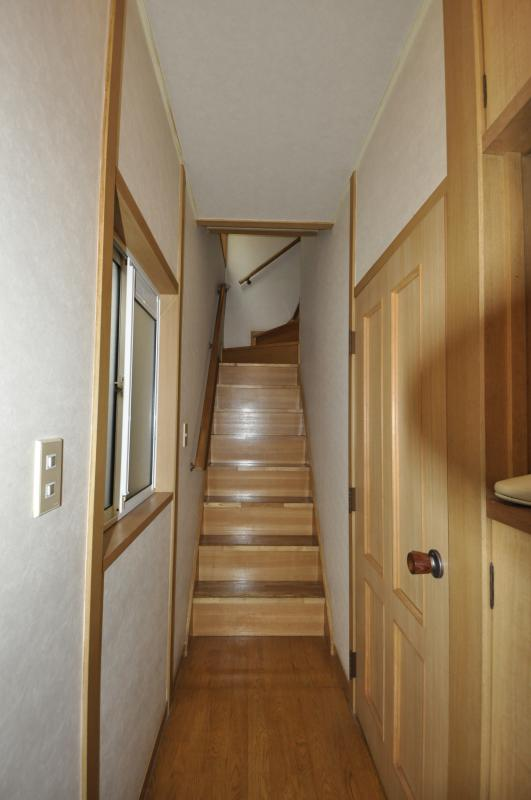 The staircase you will see once you enter the house. To the right are the first floor facilities.