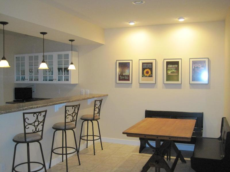 Everyone will enjoy the big kitchen, bar area & large table for cards & games  in the lower level