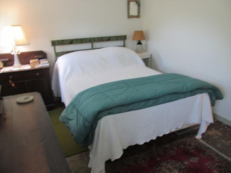 Second bedroom on second floor with 1 double bed and 1 twin bed.