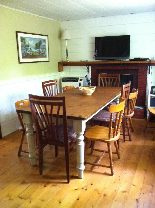 Spacious county dining table with seating for 8.  Pass the Lobster please.eh