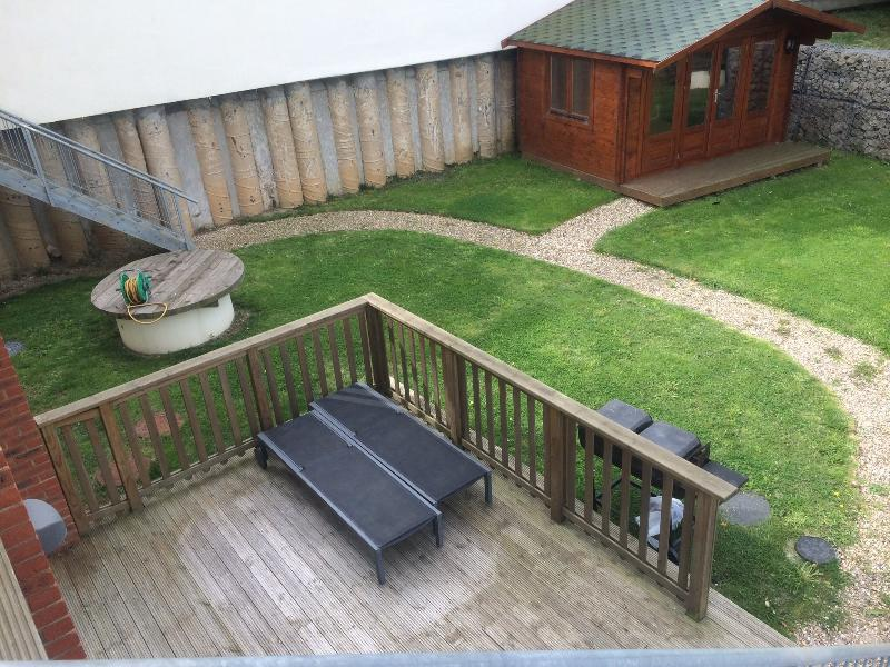 Secure garden, with sun loungers on the vast deck