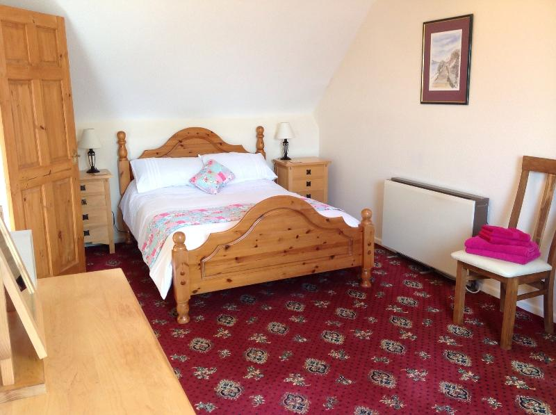 Large double bedroom upstairswith travel cot and changing mattress if required.