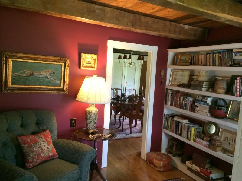 Cozy library with original hand hewn wood beams