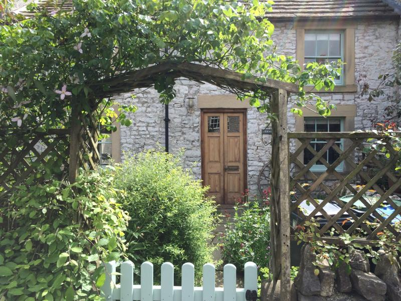 Fernlea is hidden behind its own quintessentially English country garden