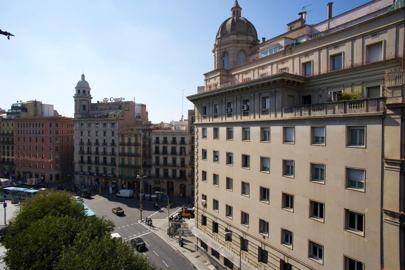 View from the balconies. The Aerobus (Airport bus) stops in Plaza Cataluña.