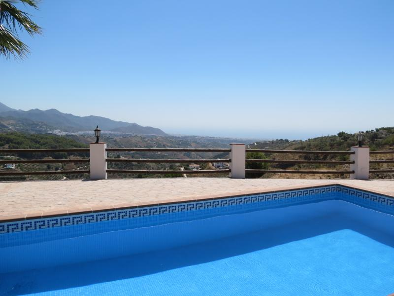 Crystal clear swimming pool with spectacular views