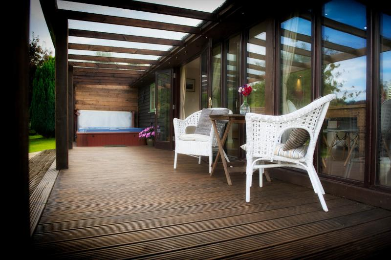 Glass covered deck with private hot tub