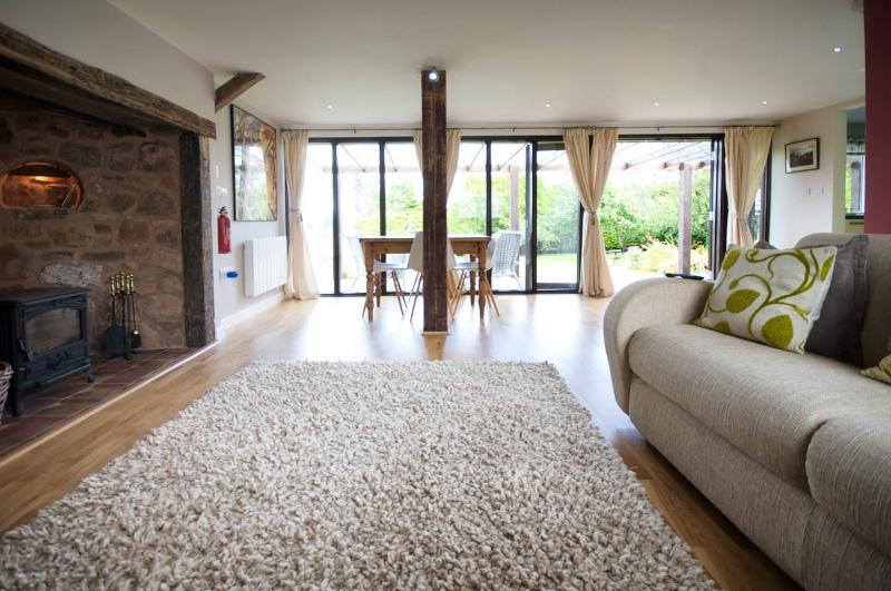 Floor to ceiling windows with rolling countryside views
